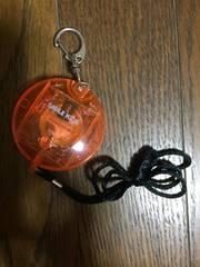 光る防犯アラーム  オレンジ スケルトン 円型