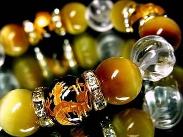 四神獣オニキス§ゴールデンタイガーアイ§トルネード水晶12ミリ金ロンデル数珠