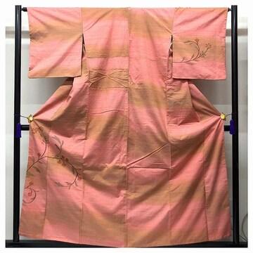 訪問着 紬 草花模様 裄65 身丈157 紋入り(ピンク)中古品