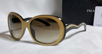 正規美 PRADAプラダ ロゴ文字ウェーブテンプルサングラス 黒×金 眼鏡 付属有